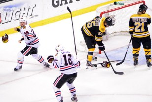 Until the fat lady sings: Just 17 seconds earlier, a game seven seemed certain, but Dave Bolland (36 in white) reminded us all that it truly ain't over until it's over.
