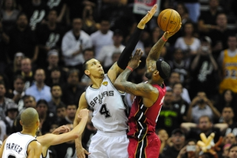 Watch out LeBron!: Danny Green gets a hand on LeBron James' layup, a key play that led the Spurs trouncing all over the Heat.
